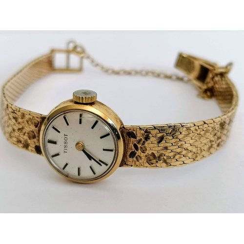 2 - A 1970s ladies Tissot wristwatch with baton markers, 9ct gold case and mesh strap, hallmarked, in wo...
