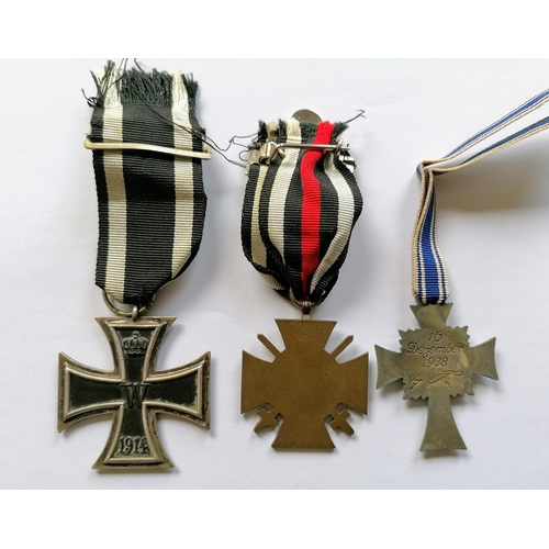 86 - A full size WW1 German 1914 Iron Cross 2nd Class medal with ribbon, War Merit Cross with swords and ...