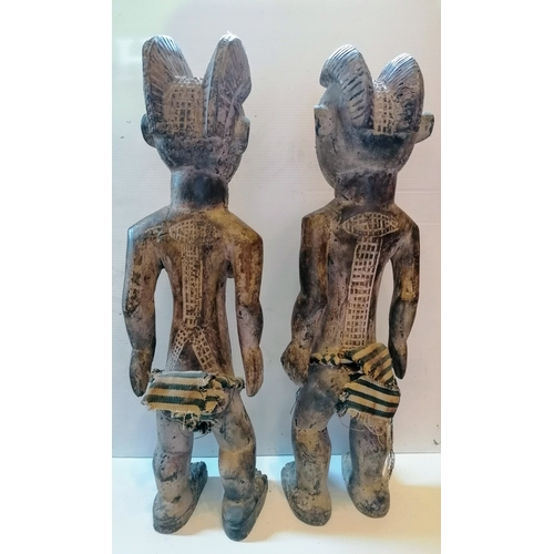 97 - A west African male and female wood tribal pair, possibly Liberia, each 62 cm H...