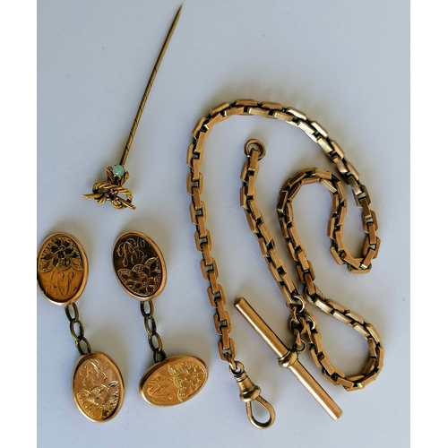A gold Albert chain with T-bar and single clasp, 32 cm, stamped 9ct, 13.37g a pair of Edwardian oval embossed cufflinks, hallmarked, 3.93g and a tie pin with opal and garnet decoration, stamped 18ct,  1.38g (3)