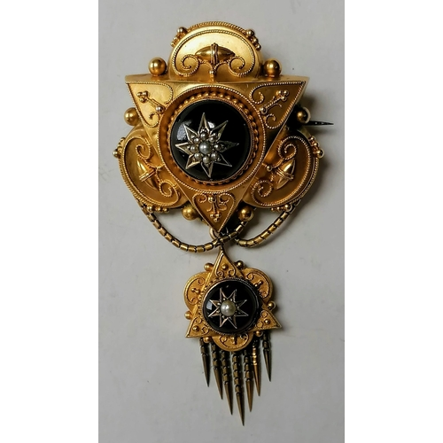 262 - A 19th century memorial pendant brooch with round garnet cabochon, decorated with seed pearls and mi...