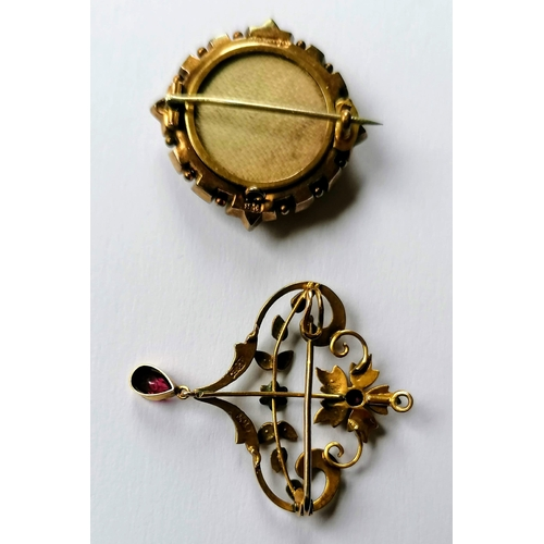 274 - An Edwardian gold memorial or mourning pendant brooch with central sapphire and seed pearl decoratio...