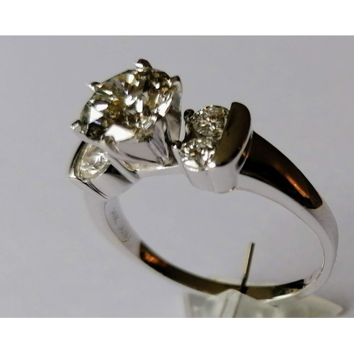 307 - A diamond ring, the central round brilliant-cut diamond measuring an estimated 8.7 x 8.6 x 5.2mm, we...