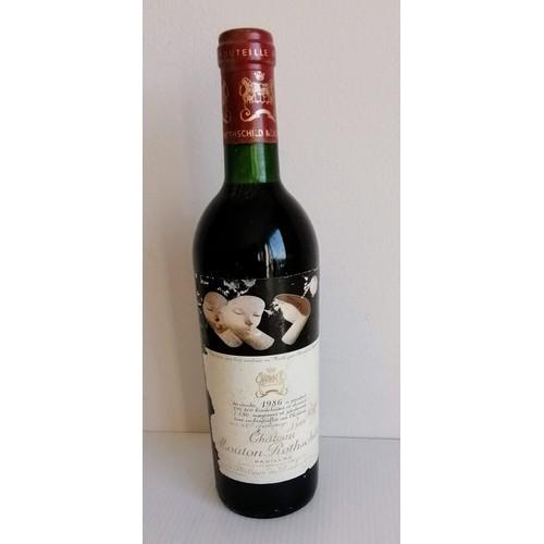 264 - Château Mouton Rothschild, Pauillac, 1986, 75cl, some label damage...