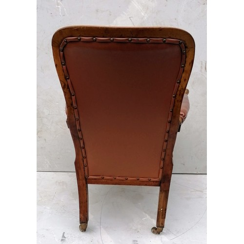 266 - A George IV walnut-framed library or club chair with later footstool, leather button-back upholstery...