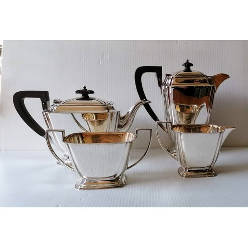108 - An Art Deco silver four-piece tea/coffee service with stylized design, reeded handles on stepped bas...