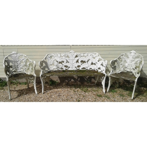 2 - A white painted cast metal Coalbrookdale style fern pattern two seat garden bench and two matching t...