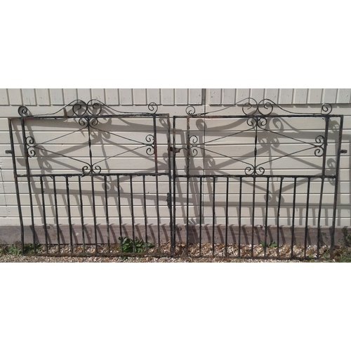 4 - A pair of wrought iron driveway gates with ornate scrolling decoration  230 cm wide and a similar pe...