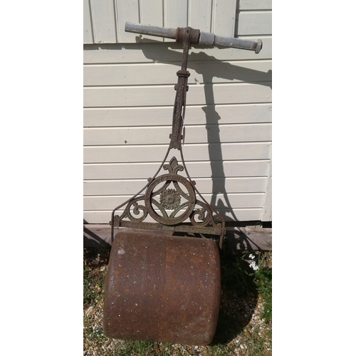 13 - A Victorian cast iron garden roller with solid metal  roller ....