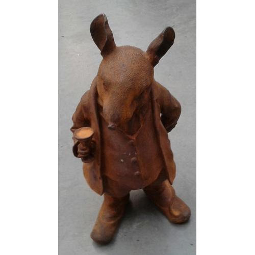 48 - A cast metal rust effect standing Mr Ratty garden ornament....