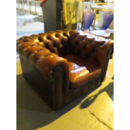 18 - AN OXBLOOD LEATHER CHESTERFIELD CHAIR...