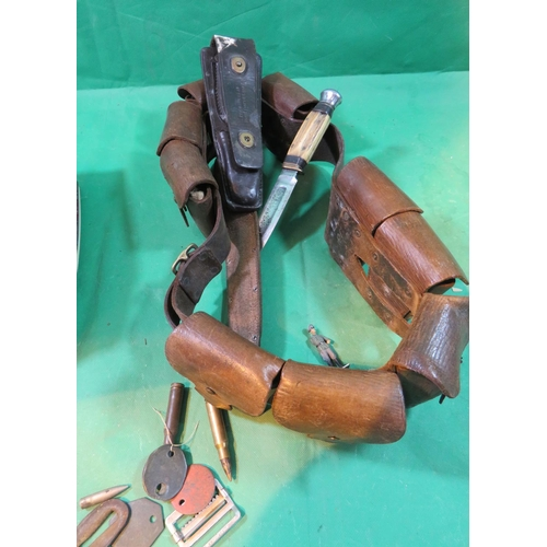 90 - A VINTAGE LEATHER MILITARY BELT WITH ASSOCIATED KNIVES - LEATHER POUCH - I.D TAGS AND OTHER ITEMS...