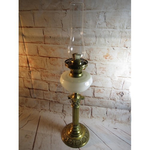 212 - A VINTAGE - ANTIQUE STYLE BRASS OIL LAMP...