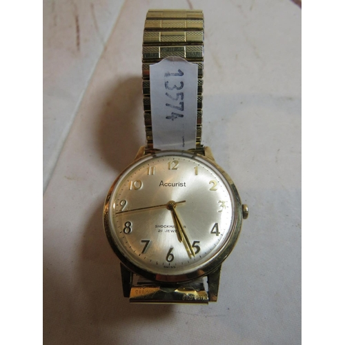 309 - A NINE CARAT GOLD CASED - ACCURIST TWENTY ONE JEWELS - SHOCK MASTER WATCH - WITH FIXO-FLEX GOLD PLAT...