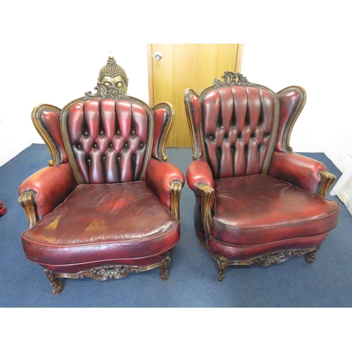 85 - A PAIR OF OXBLOOD COLOURED - LEATHER CHESTERFIELD STYLE CHAIRS...