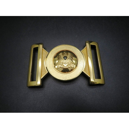 17A - A brass plated - military belt buckle...