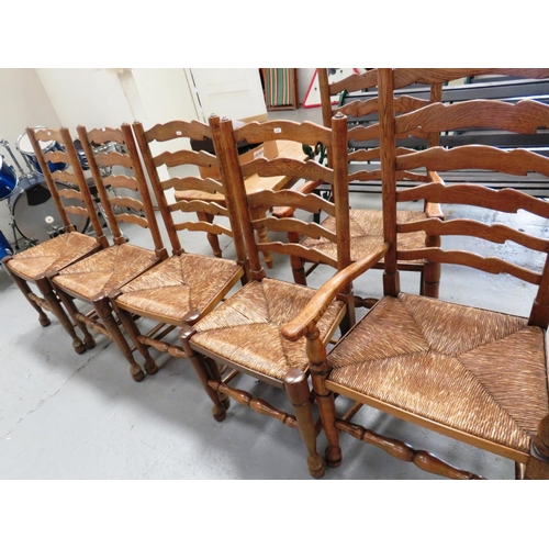 42 - SIX VINTAGE FRENCH - OAK AND RUSH SEATED - LADDERBACK CHAIRS - INCLUDING TWO CARVERS...