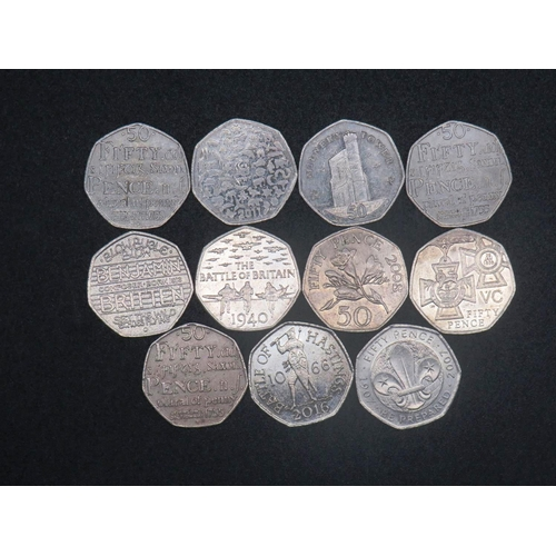 330 - ELEVEN - FIFTY PENCE COINS...