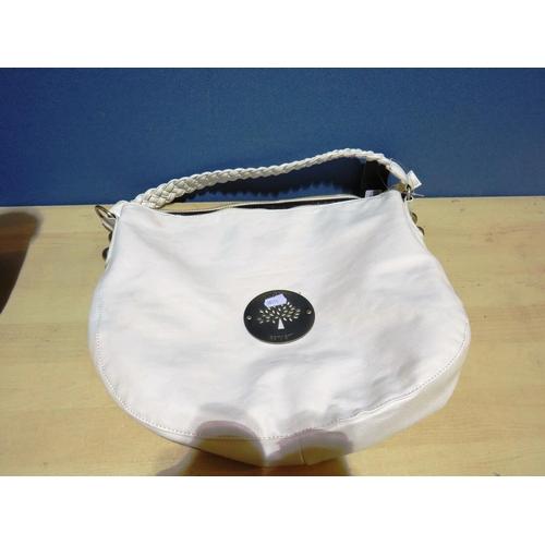 520 - LADIES CREAM BAG...