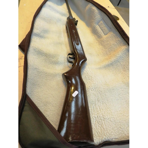 158 - .22 RIFLE WITH CASE IN WORKING ORDER...