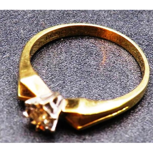 309 - A 14ct GOLD SOLITAIRE RING...