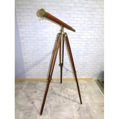 64 - HARDWOOD AND BRASS TELESCOPE ON LARGE TRIPOD STAND...