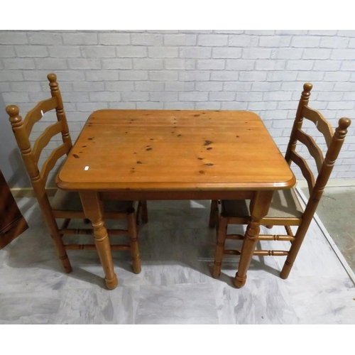 23 - PINE TABLE AND TWO CHAIRS...