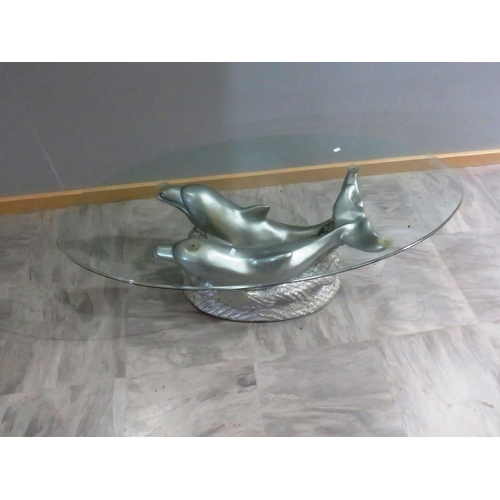 32 - A GLASS TOPPED DOLPHIN COFFEE TABLE...