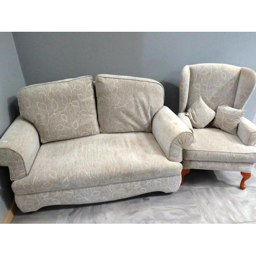 34 - TWO SEATER SOFA AND WINGBACK CHAIR...