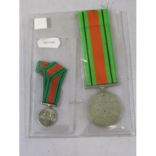 469 - WWII FULL SIZE AND MINIATURE DEFENCE MEDALS...
