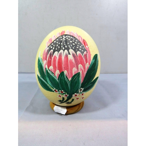 207 - HAND PAINTED OSTRICH EGG ON WOOD BASE...