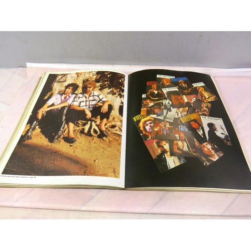 174 - BOB DYLAN BOOK - WITH AUTOGRAPHS OF BOB DYLAN, MICK JAGGER, KEITH RICHARDS, CHARLIE WATTS AND RONNIE...