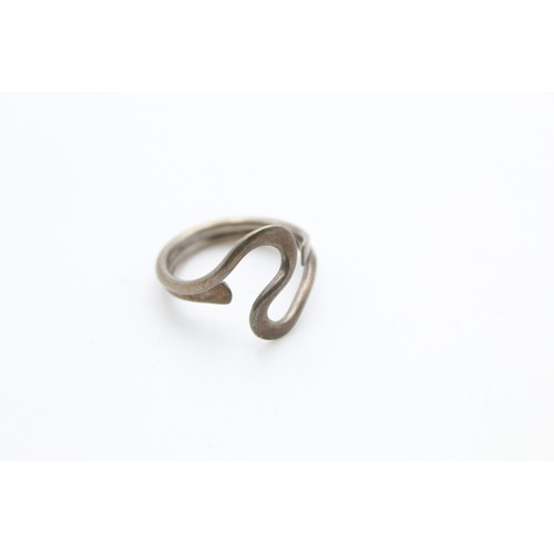 32 - Silver Modernist Design Ring...