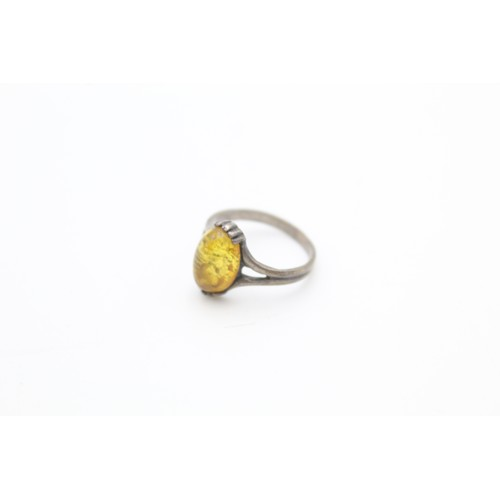 34 - Sterling Silver Oval Amber Ring...