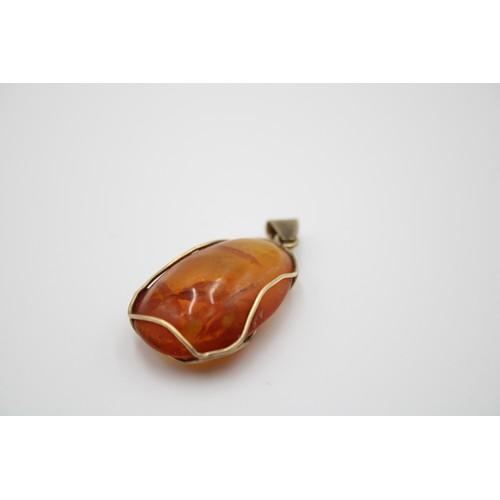 36 - 9ct Gold Polished Amber Pebble Pendant...