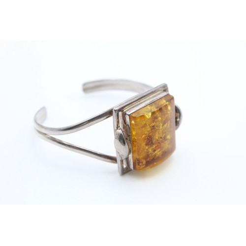 56 - Sterling Silver Torque Amber Bangle...