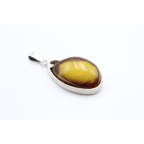 58 - Sterling Silver Modernist Unusual Amber Polished Pendant...