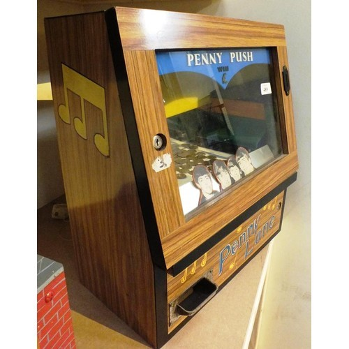 379 - ORIGINAL MINIATURE PENNY PUSH IN FULL WORKING ORDER THIS IS A ONE OF A KIND EXTREMELY RARE WITH PENN...