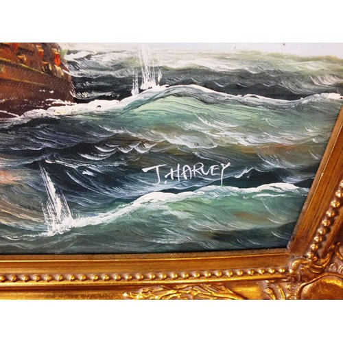 577 - TWO ORIGINAL J.HARVEY SIGNED OIL ON CANVAS PAINTINGS OF FIGHTING GALLEONS IN GOLD GILT FRAMES AND ON...