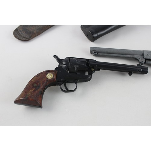 212 - 2 x Assorted Vintage Replica PISTOLS w/ Leather Belt & Holsters