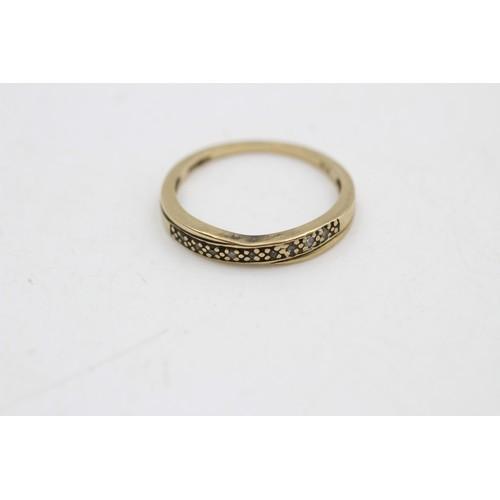 286 - 9ct gold diamond half-eternity crossover ring (1.5g)