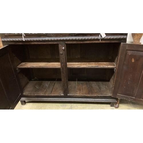 11 - <B>A late 18th century carved oak court cupboard, width 130cm, depth 52cm, height 170cm</b></i>...