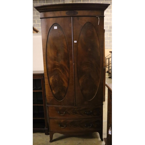 19 - <B>A 1920's George III style mahogany bow front wardrobe with two drawers, with key, width 102cm dep...