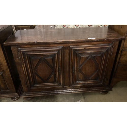 23 - <B>A mid 18th century French provincial oak and elm two door cupboard, with fruitwood top, width 129...