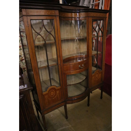 24 - <B>An Edwardian marquetry inlaid mahogany bow fronted display cabinet</b></i>...