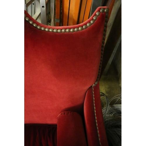 25 - <B>An Yves Halard two-seater sofa covered in red velvet, width 125cm depth 85cm height 132cm</b></i>...