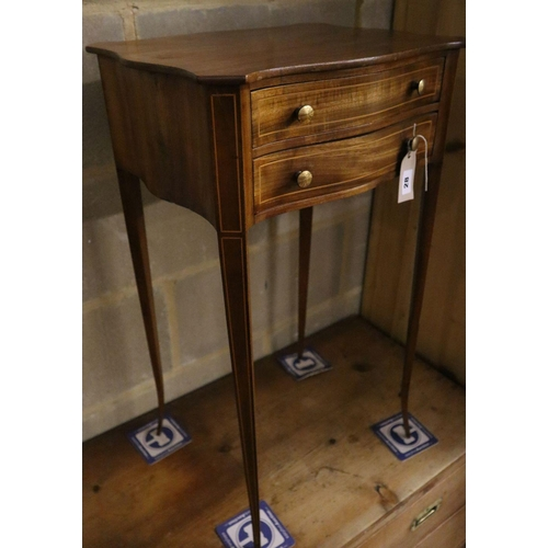 28 - <B>A small 19th century serpentine mahogany side table fitted two drawers, width 42cm depth 33cm hei...