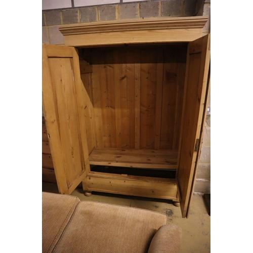 30 - <B>A 19th century Eastern European pine armoire, width 124cm depth 61cm height 192cm</b></i>...