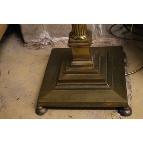 31 - <B>A brass Corinthian column adjustable standard lamp</b></i>...