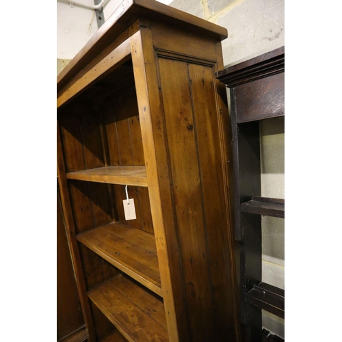 38 - <B>A modern stained pine open shelved bookcase, width 98cm depth 33cm height 198cm</b></i>...